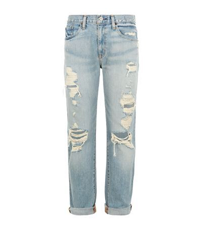 Distressed Boyfriend Jeans - style: boyfriend; length: standard; pattern: plain; pocket detail: traditional 5 pocket; waist: mid/regular rise; predominant colour: denim; occasions: casual; fibres: cotton - 100%; jeans detail: shading down centre of thigh, washed/faded, rips; jeans & bottoms detail: turn ups; texture group: denim; pattern type: fabric; season: s/s 2015; wardrobe: basic