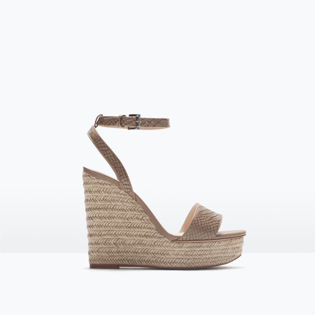 Patterned Wedges - predominant colour: taupe; occasions: casual, holiday; material: faux leather; ankle detail: ankle strap; heel: wedge; toe: open toe/peeptoe; style: strappy; finish: plain; pattern: animal print; heel height: very high; shoe detail: platform; season: s/s 2015; wardrobe: highlight