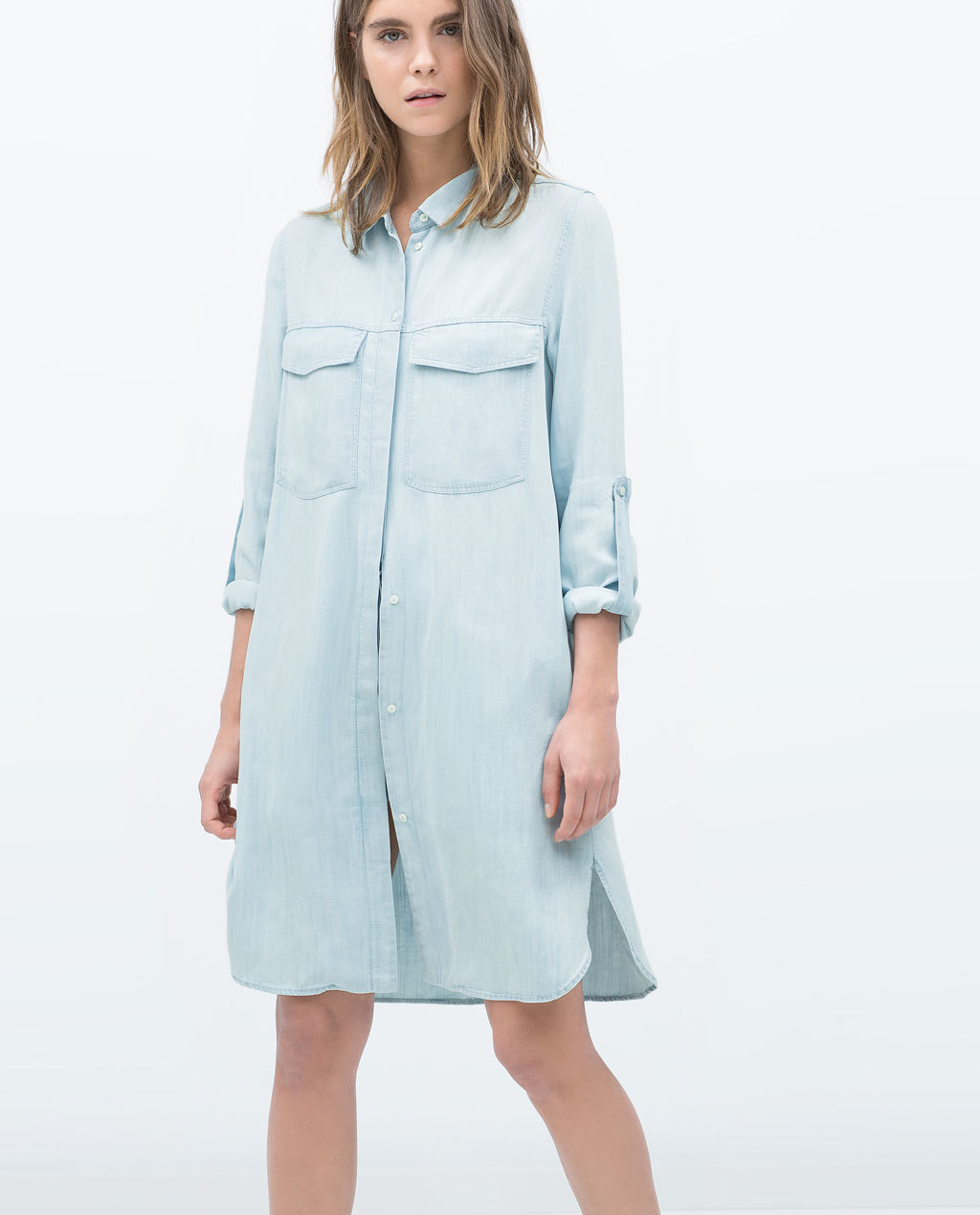 Long Denim Shirt Dress - style: shirt; neckline: shirt collar/peter pan/zip with opening; fit: loose; pattern: plain; predominant colour: pale blue; occasions: casual; length: just above the knee; fibres: cotton - 100%; sleeve length: 3/4 length; sleeve style: standard; texture group: denim; bust detail: bulky details at bust; pattern type: fabric; trends: alternative denim; season: s/s 2015; wardrobe: basic