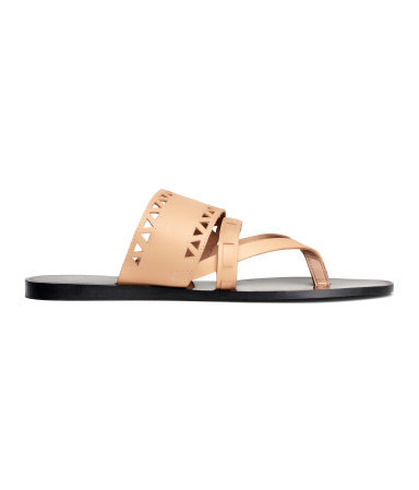 Leather Sandals - predominant colour: nude; occasions: casual, holiday; material: leather; heel height: flat; heel: standard; toe: toe thongs; style: slides; finish: plain; pattern: plain; season: s/s 2015; wardrobe: highlight