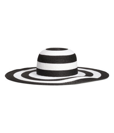 Straw Hat - secondary colour: white; predominant colour: black; type of pattern: standard; style: wide brimmed; size: large; material: macrame/raffia/straw; pattern: striped; occasions: holiday; season: s/s 2015; wardrobe: holiday
