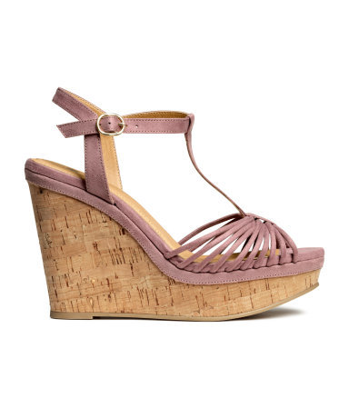 Sandals With A Wedge Heel - occasions: casual; material: faux leather; heel height: high; ankle detail: ankle strap; heel: wedge; toe: open toe/peeptoe; style: strappy; finish: plain; pattern: plain; predominant colour: dusky pink; shoe detail: platform; season: s/s 2015; wardrobe: highlight