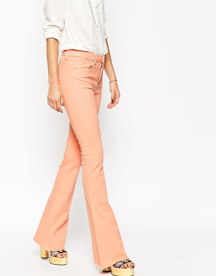 Bell Flare Jeans With Raw Hem Pink - style: flares; length: standard; pattern: plain; pocket detail: traditional 5 pocket; waist: mid/regular rise; predominant colour: blush; occasions: casual; fibres: cotton - stretch; texture group: denim; pattern type: fabric; trends: seventies retro; season: s/s 2015; wardrobe: highlight
