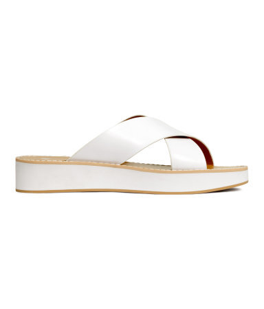 Platform Sandals - predominant colour: white; occasions: casual, holiday; material: plastic/rubber; heel height: flat; heel: block; toe: open toe/peeptoe; style: slides; finish: patent; pattern: plain; shoe detail: platform; season: s/s 2015; wardrobe: highlight