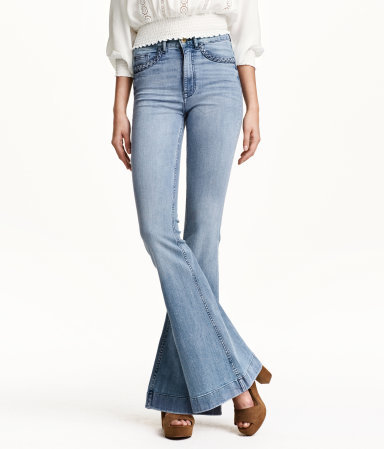 Flare High Waist Jeans - style: flares; length: standard; pattern: plain; waist: high rise; pocket detail: traditional 5 pocket; predominant colour: denim; occasions: casual; fibres: cotton - 100%; jeans detail: washed/faded; texture group: denim; pattern type: fabric; trends: seventies retro; season: s/s 2015; wardrobe: basic