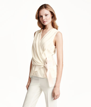 Wraparound Blouse - neckline: v-neck; pattern: plain; sleeve style: sleeveless; style: wrap/faux wrap; waist detail: belted waist/tie at waist/drawstring; predominant colour: ivory/cream; occasions: evening, work, occasion, creative work; length: standard; fibres: polyester/polyamide - 100%; fit: body skimming; sleeve length: sleeveless; texture group: sheer fabrics/chiffon/organza etc.; pattern type: fabric; trends: chalky neutrals; season: s/s 2015; wardrobe: basic