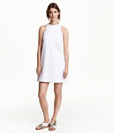 Textured Dress - style: shift; length: mini; pattern: plain; sleeve style: sleeveless; predominant colour: ivory/cream; occasions: casual, evening; fit: soft a-line; fibres: polyester/polyamide - 100%; neckline: crew; hip detail: sculpting darts/pleats/seams at hip; sleeve length: sleeveless; pattern type: fabric; texture group: woven light midweight; season: s/s 2015; wardrobe: basic