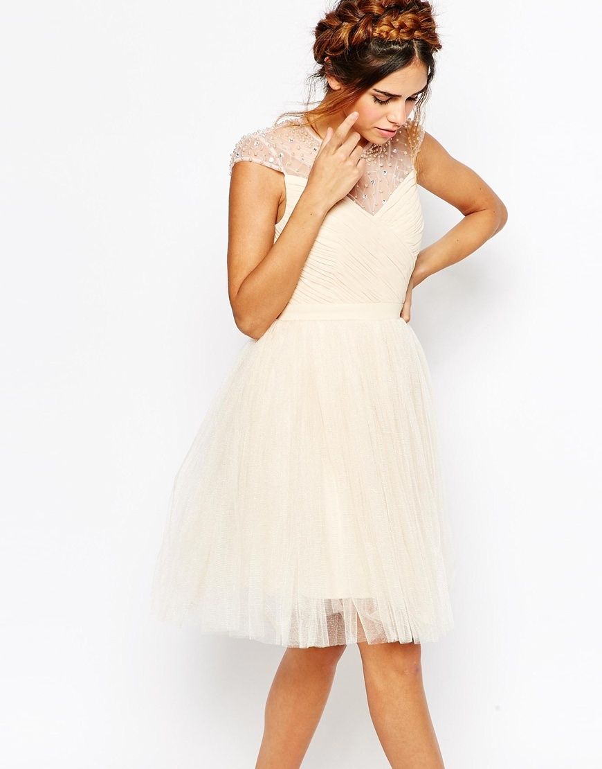 Ruched Bodice Skater Dress With Pleated Tulle Skirt Cream - neckline: round neck; sleeve style: capped; pattern: plain; predominant colour: ivory/cream; occasions: evening, occasion; length: on the knee; fit: fitted at waist & bust; style: fit & flare; fibres: polyester/polyamide - 100%; sleeve length: short sleeve; texture group: sheer fabrics/chiffon/organza etc.; pattern type: fabric; embellishment: pearls; shoulder detail: sheer at shoulder; season: s/s 2015; wardrobe: event; embellishment location: shoulder