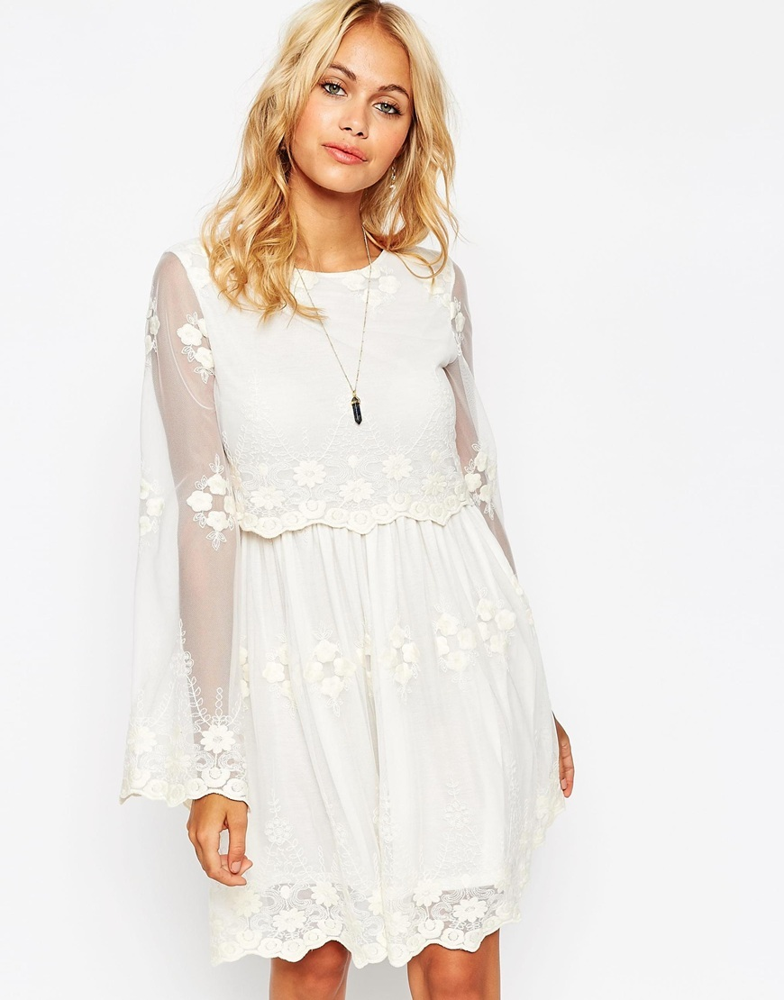 Skater Dress In Lace With Double Layer Cream - neckline: round neck; sleeve style: angel/waterfall; pattern: plain; predominant colour: ivory/cream; length: just above the knee; fit: soft a-line; style: fit & flare; occasions: occasion; sleeve length: long sleeve; texture group: sheer fabrics/chiffon/organza etc.; pattern type: fabric; embellishment: embroidered; season: a/w 2015; wardrobe: event