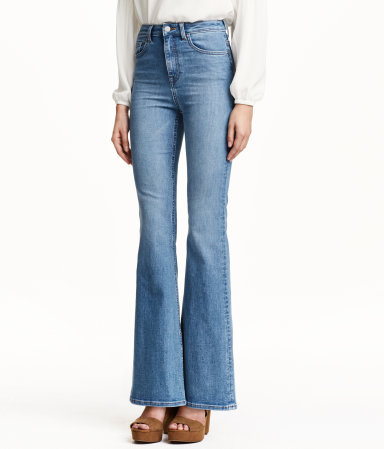Flare Jeans - style: flares; length: standard; pattern: plain; waist: high rise; pocket detail: traditional 5 pocket; predominant colour: denim; occasions: casual, creative work; fibres: cotton - stretch; jeans detail: shading down centre of thigh; texture group: denim; pattern type: fabric; season: a/w 2015; trends: folky 70s