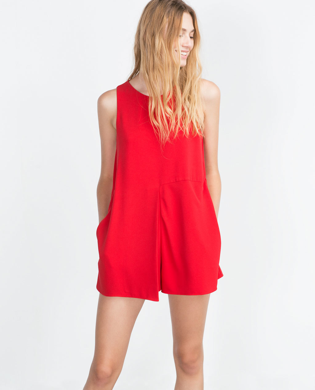 Front Pleat Jumpsuit - neckline: round neck; fit: loose; pattern: plain; sleeve style: sleeveless; length: short shorts; predominant colour: true red; occasions: casual, evening; fibres: polyester/polyamide - 100%; sleeve length: sleeveless; texture group: crepes; style: playsuit; pattern type: fabric; season: a/w 2015