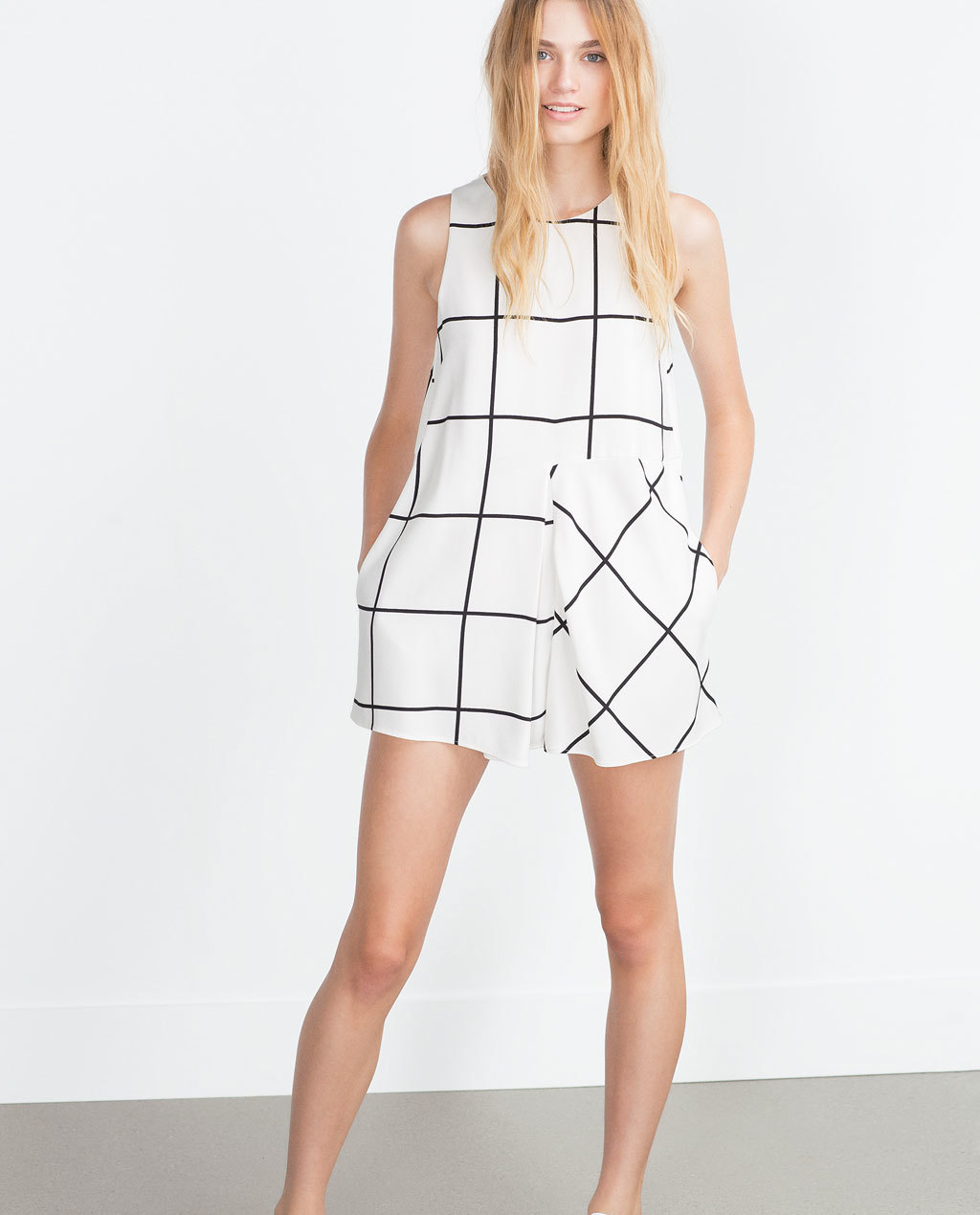 Front Pleat Jumpsuit - fit: loose; sleeve style: sleeveless; pattern: checked/gingham; length: short shorts; predominant colour: white; secondary colour: black; occasions: casual, evening; fibres: polyester/polyamide - 100%; neckline: crew; sleeve length: sleeveless; style: playsuit; pattern type: fabric; pattern size: standard; texture group: other - light to midweight; season: a/w 2015; wardrobe: highlight