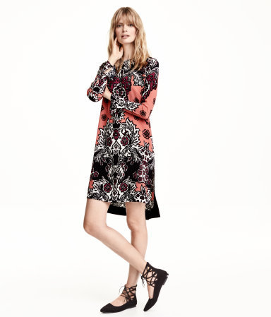 Patterned Dress - style: tunic; length: mini; neckline: round neck; pattern: paisley; secondary colour: coral; predominant colour: black; occasions: casual, evening, creative work; fit: straight cut; fibres: polyester/polyamide - 100%; sleeve length: long sleeve; sleeve style: standard; texture group: crepes; pattern type: fabric; pattern size: standard; multicoloured: multicoloured; season: a/w 2015; wardrobe: highlight