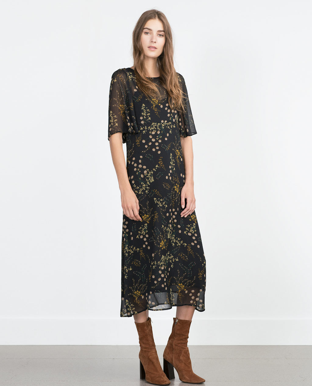 Printed Dress - style: shift; length: calf length; neckline: round neck; secondary colour: mustard; predominant colour: black; occasions: casual, creative work; fit: soft a-line; fibres: polyester/polyamide - 100%; sleeve length: half sleeve; sleeve style: standard; texture group: sheer fabrics/chiffon/organza etc.; pattern type: fabric; pattern size: standard; pattern: florals; multicoloured: multicoloured; season: a/w 2015; trends: folky 70s