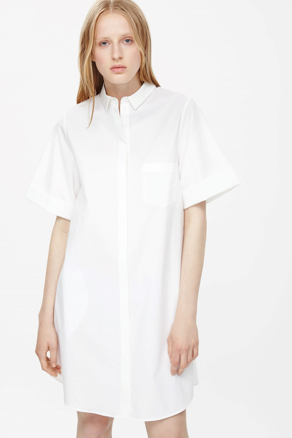 Cuffed Shirt Dress - style: shirt; length: mid thigh; neckline: shirt collar/peter pan/zip with opening; pattern: plain; predominant colour: white; occasions: casual; fit: straight cut; fibres: cotton - 100%; sleeve length: short sleeve; sleeve style: standard; texture group: cotton feel fabrics; pattern type: fabric; season: a/w 2015; wardrobe: basic