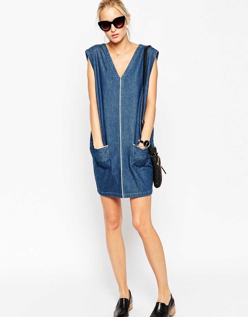 Selvedge Denim Dress Blue - style: tunic; length: mid thigh; neckline: low v-neck; pattern: plain; sleeve style: sleeveless; hip detail: front pockets at hip; predominant colour: denim; occasions: casual, creative work; fit: body skimming; fibres: cotton - mix; sleeve length: sleeveless; texture group: denim; pattern type: fabric; embellishment: zips; season: a/w 2015; wardrobe: highlight