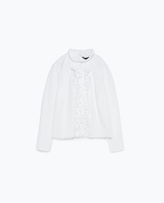 Top With Frill - pattern: plain; neckline: high neck; predominant colour: white; occasions: casual, work, creative work; length: standard; style: top; fibres: cotton - stretch; fit: body skimming; sleeve length: long sleeve; sleeve style: standard; texture group: cotton feel fabrics; bust detail: tiers/frills/bulky drapes/pleats; pattern type: fabric; season: a/w 2015; wardrobe: highlight