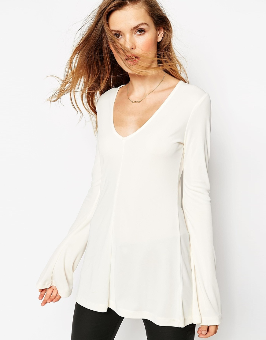 Clean Longline Top With V Neck And Long Sleeves Cream - neckline: low v-neck; sleeve style: angel/waterfall; pattern: plain; length: below the bottom; style: tunic; predominant colour: ivory/cream; occasions: casual, creative work; fibres: polyester/polyamide - 100%; fit: loose; sleeve length: long sleeve; texture group: knits/crochet; pattern type: fabric; season: a/w 2015; wardrobe: basic