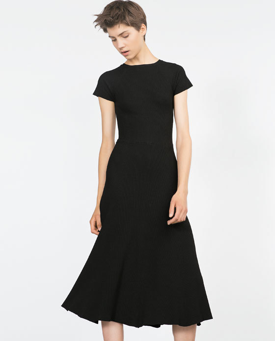 Short Sleeve Dress - style: shift; length: below the knee; pattern: plain; predominant colour: black; occasions: evening, work, occasion, creative work; fit: fitted at waist & bust; fibres: polyester/polyamide - 100%; neckline: crew; sleeve length: short sleeve; sleeve style: standard; pattern type: fabric; texture group: jersey - stretchy/drapey; season: a/w 2015; wardrobe: investment