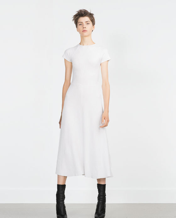 Short Sleeve Dress - length: calf length; sleeve style: capped; pattern: plain; predominant colour: ivory/cream; fit: fitted at waist & bust; style: fit & flare; fibres: polyester/polyamide - 100%; occasions: occasion; neckline: crew; hip detail: soft pleats at hip/draping at hip/flared at hip; sleeve length: short sleeve; pattern type: fabric; texture group: other - light to midweight; season: a/w 2015