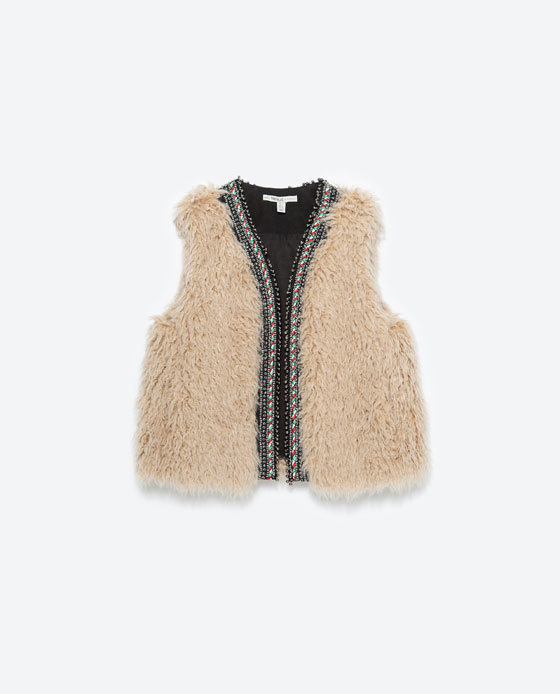 Furry Waistcoat - pattern: plain; sleeve style: sleeveless; style: gilet; collar: round collar/collarless; predominant colour: ivory/cream; secondary colour: black; occasions: casual, creative work; length: standard; fit: straight cut (boxy); fibres: cotton - 100%; sleeve length: sleeveless; collar break: low/open; pattern type: fabric; texture group: sheepskin; season: a/w 2015; trends: folky 70s, warm and fuzzy; wardrobe: highlight