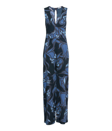 Patterned Jumpsuit - length: standard; neckline: low v-neck; sleeve style: sleeveless; secondary colour: royal blue; predominant colour: navy; occasions: casual, evening; fit: body skimming; fibres: polyester/polyamide - 100%; sleeve length: sleeveless; style: jumpsuit; pattern type: fabric; pattern: patterned/print; texture group: jersey - stretchy/drapey; multicoloured: multicoloured; season: a/w 2015; wardrobe: highlight
