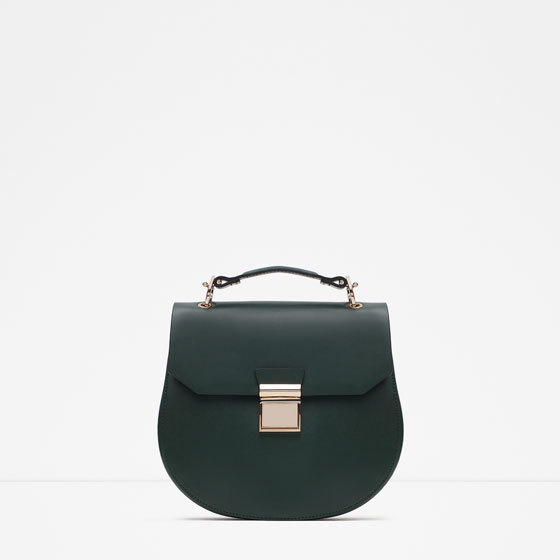 Oval Messenger Bag - predominant colour: dark green; occasions: casual, creative work; type of pattern: standard; style: saddle; length: across body/long; size: small; material: faux leather; pattern: plain; finish: plain; season: a/w 2015; wardrobe: highlight