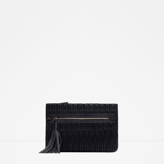 Padded Clutch Bag - predominant colour: black; occasions: evening, occasion; type of pattern: standard; style: clutch; length: hand carry; size: small; material: faux leather; embellishment: tassels; pattern: plain; finish: plain; season: a/w 2015; wardrobe: event