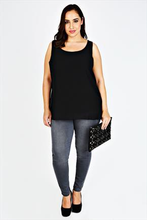 Black Sleeveless Top With Lace & Bow Back - sleeve style: standard vest straps/shoulder straps; pattern: plain; length: below the bottom; style: vest top; back detail: contrast pattern/fabric at back; predominant colour: black; occasions: casual, evening, creative work; neckline: scoop; fibres: polyester/polyamide - 100%; fit: body skimming; sleeve length: sleeveless; pattern type: fabric; texture group: jersey - stretchy/drapey; season: a/w 2015