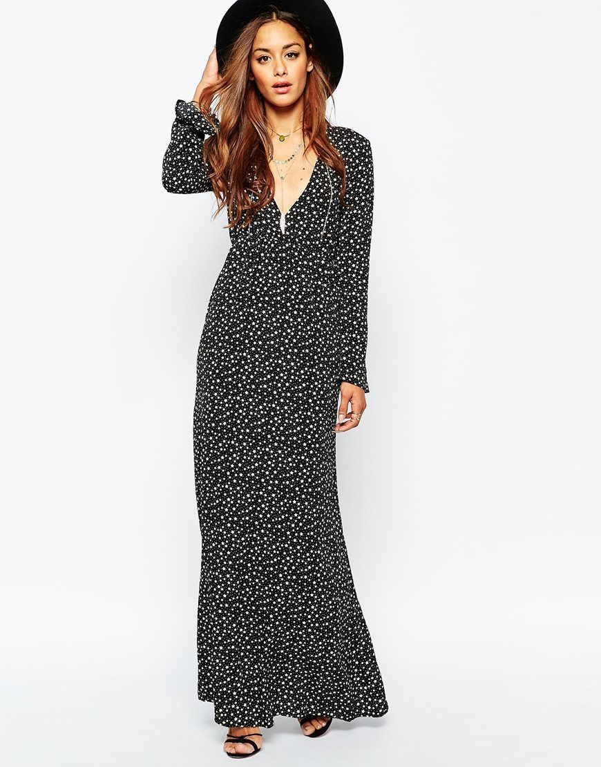 Plunge Boho Maxi Dress Black - neckline: low v-neck; style: maxi dress; secondary colour: white; predominant colour: black; occasions: evening, creative work; length: floor length; fit: body skimming; fibres: polyester/polyamide - 100%; sleeve length: long sleeve; sleeve style: standard; pattern type: fabric; pattern: patterned/print; texture group: woven light midweight; multicoloured: multicoloured; season: a/w 2015; wardrobe: highlight