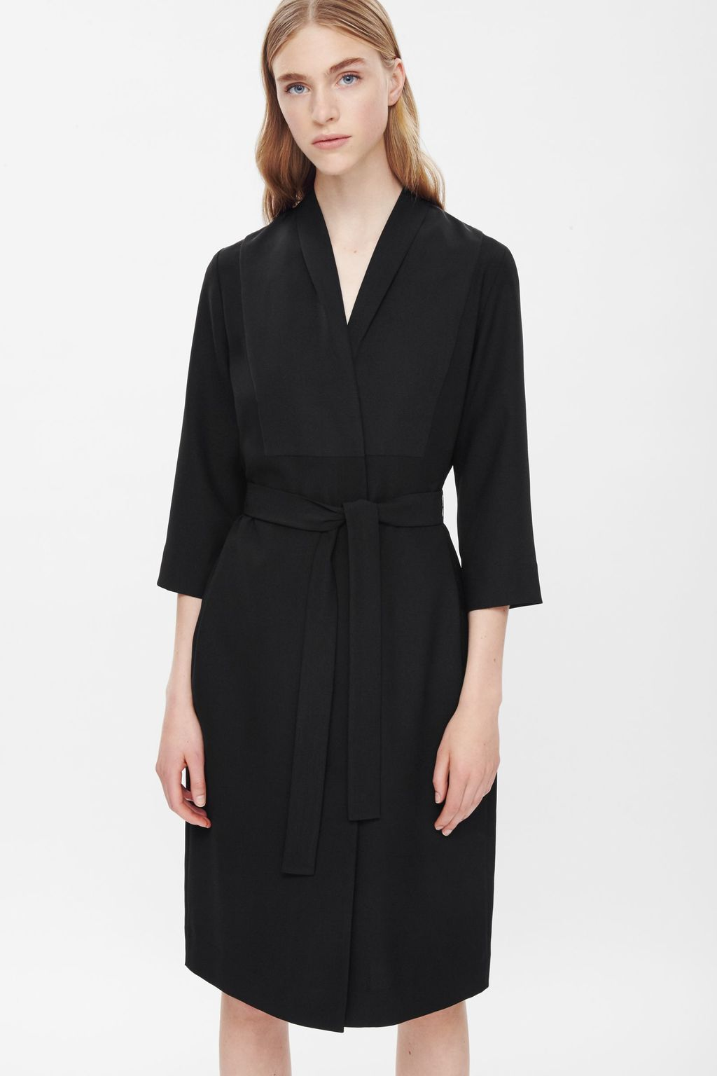 Long Blazer Dress - style: faux wrap/wrap; neckline: v-neck; fit: fitted at waist; pattern: plain; waist detail: belted waist/tie at waist/drawstring; predominant colour: black; occasions: casual, work, creative work; length: on the knee; fibres: polyester/polyamide - 100%; sleeve length: 3/4 length; sleeve style: standard; pattern type: fabric; texture group: woven light midweight; season: a/w 2015; wardrobe: basic