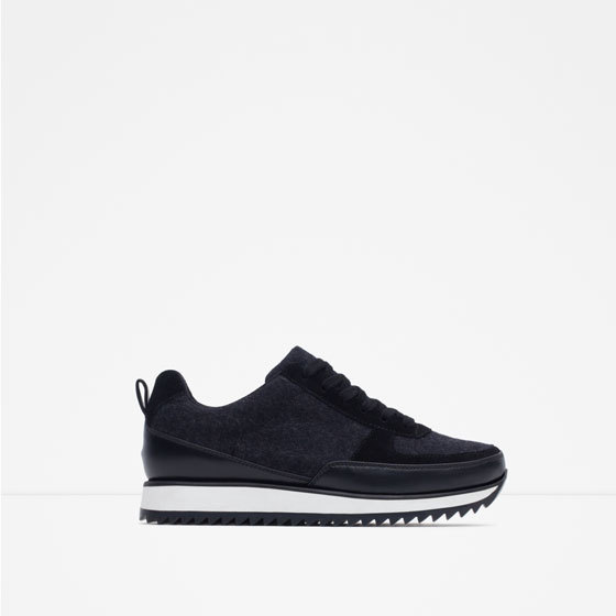 Combined Sneakers - predominant colour: black; occasions: casual, activity; material: faux leather; heel height: flat; toe: round toe; style: trainers; trends: monochrome; finish: plain; pattern: plain; shoe detail: platform with tread; season: a/w 2015