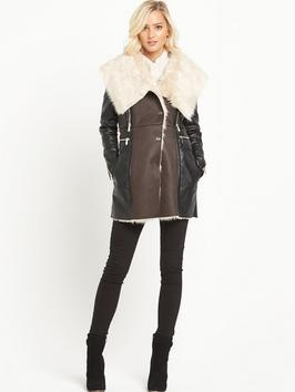 Shearling Mix Coat - style: wrap around; length: mid thigh; predominant colour: chocolate brown; secondary colour: black; occasions: casual, creative work; fit: straight cut (boxy); fibres: leather - 100%; hip detail: contrast fabric/print detail at hip; sleeve length: long sleeve; sleeve style: standard; collar: fur; collar break: medium; pattern type: fabric; pattern: colourblock; texture group: sheepskin; season: a/w 2015; trends: the outerwear edit; wardrobe: highlight