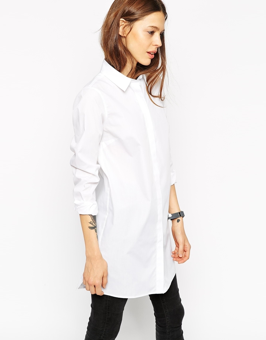Longline White Shirt White - neckline: shirt collar/peter pan/zip with opening; pattern: plain; length: below the bottom; style: shirt; predominant colour: white; occasions: casual, evening, creative work; fibres: cotton - stretch; fit: straight cut; sleeve length: 3/4 length; sleeve style: standard; texture group: cotton feel fabrics; pattern type: fabric; season: a/w 2015; wardrobe: basic