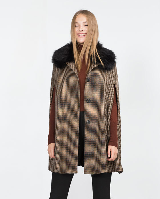 Houndstooth Cape - length: below the bottom; fit: loose; style: cape; predominant colour: camel; secondary colour: black; occasions: casual, creative work; pattern: dogtooth; sleeve length: 3/4 length; collar: fur; collar break: high; pattern type: fabric; texture group: woven bulky/heavy; sleeve style: cape/poncho sleeve; season: a/w 2015; wardrobe: highlight