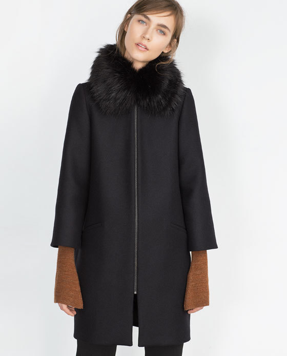 Cape Coat - pattern: plain; sleeve style: sleeveless; style: single breasted; length: mid thigh; predominant colour: black; occasions: casual, creative work; fit: straight cut (boxy); sleeve length: 3/4 length; collar: fur; collar break: high; pattern type: fabric; texture group: woven bulky/heavy; embellishment: fur; season: a/w 2015; wardrobe: highlight