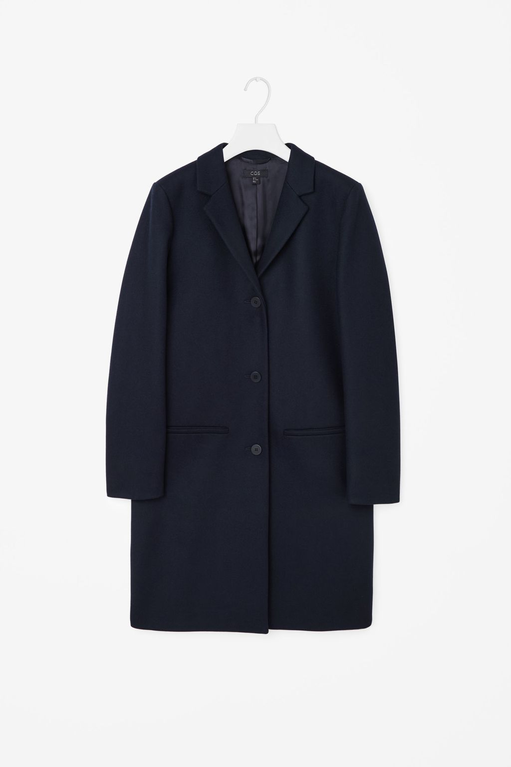 Tailored Wool Coat - pattern: plain; style: single breasted; collar: standard lapel/rever collar; length: mid thigh; predominant colour: navy; occasions: casual, work, creative work; fit: straight cut (boxy); fibres: wool - 100%; sleeve length: long sleeve; sleeve style: standard; collar break: medium; pattern type: fabric; texture group: woven bulky/heavy; season: a/w 2015; wardrobe: basic