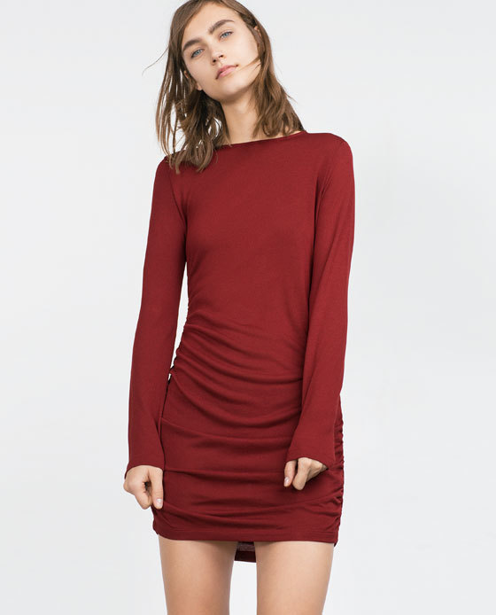 Dress With Side Gathering - style: shift; length: mini; neckline: slash/boat neckline; pattern: plain; predominant colour: true red; occasions: casual, evening; fit: body skimming; hip detail: ruching/gathering at hip; sleeve length: long sleeve; sleeve style: standard; pattern type: fabric; texture group: jersey - stretchy/drapey; season: a/w 2015