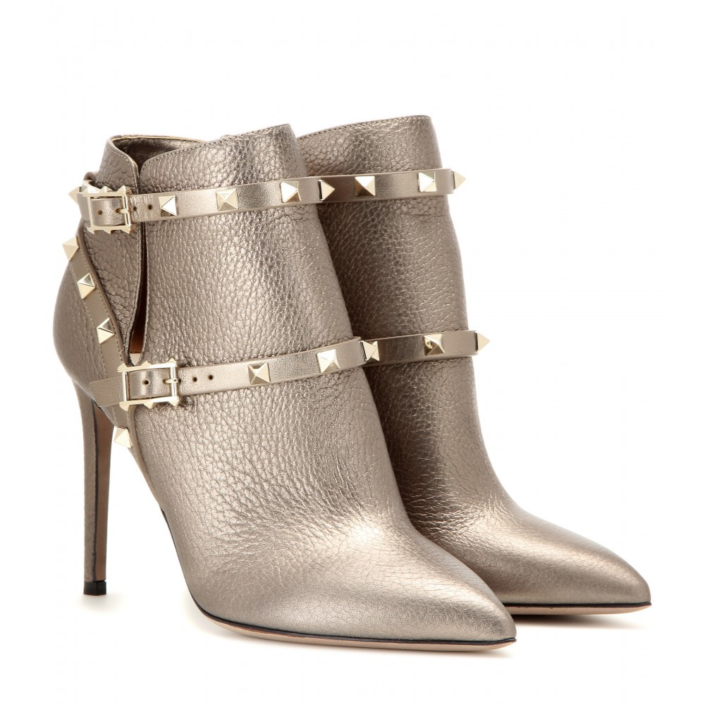 Garavani Rockstud Metallic Leather Ankle Boots - predominant colour: gold; material: leather; heel height: high; embellishment: studs; heel: standard; toe: pointed toe; boot length: ankle boot; style: standard; finish: metallic; pattern: plain; occasions: creative work; season: a/w 2015; wardrobe: highlight