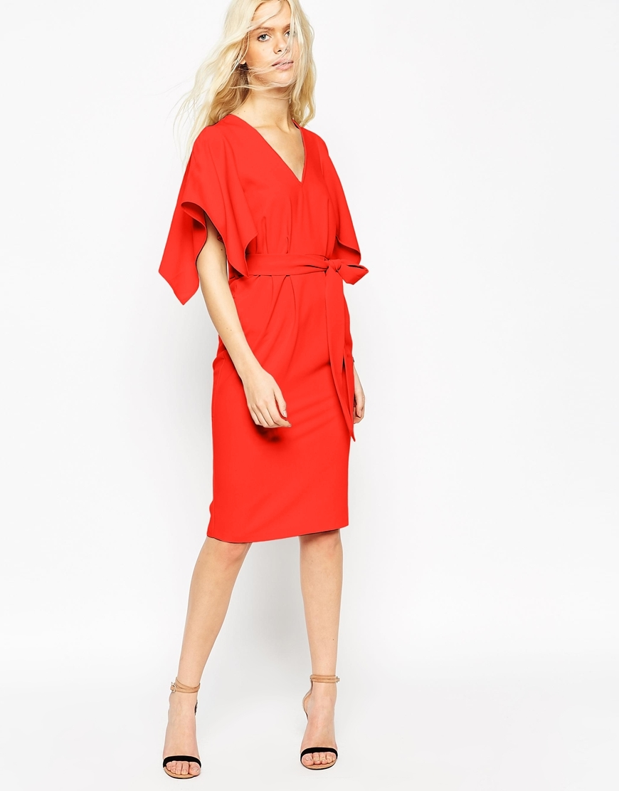 Angel Kimono Sleeve Belted Midi Dress Blood Orange - style: faux wrap/wrap; neckline: v-neck; pattern: plain; sleeve style: kimono; waist detail: belted waist/tie at waist/drawstring; predominant colour: bright orange; occasions: evening; length: on the knee; fit: body skimming; fibres: polyester/polyamide - stretch; sleeve length: half sleeve; texture group: crepes; pattern type: fabric; season: a/w 2015