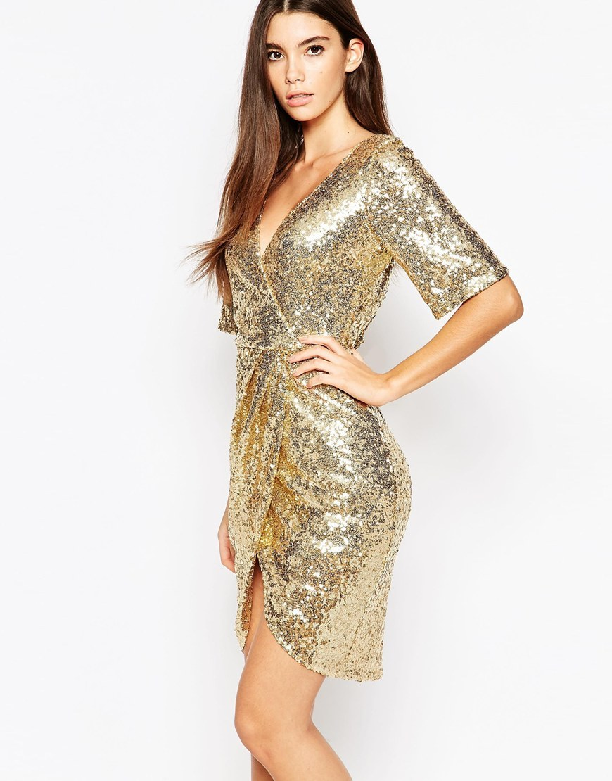Kimono Sleeve Sequin Dress With Wrap Skirt Shiny Gold - style: faux wrap/wrap; neckline: low v-neck; fit: tailored/fitted; pattern: plain; predominant colour: gold; occasions: evening; length: just above the knee; fibres: polyester/polyamide - stretch; sleeve length: half sleeve; sleeve style: standard; pattern type: fabric; texture group: jersey - stretchy/drapey; embellishment: sequins; season: a/w 2015
