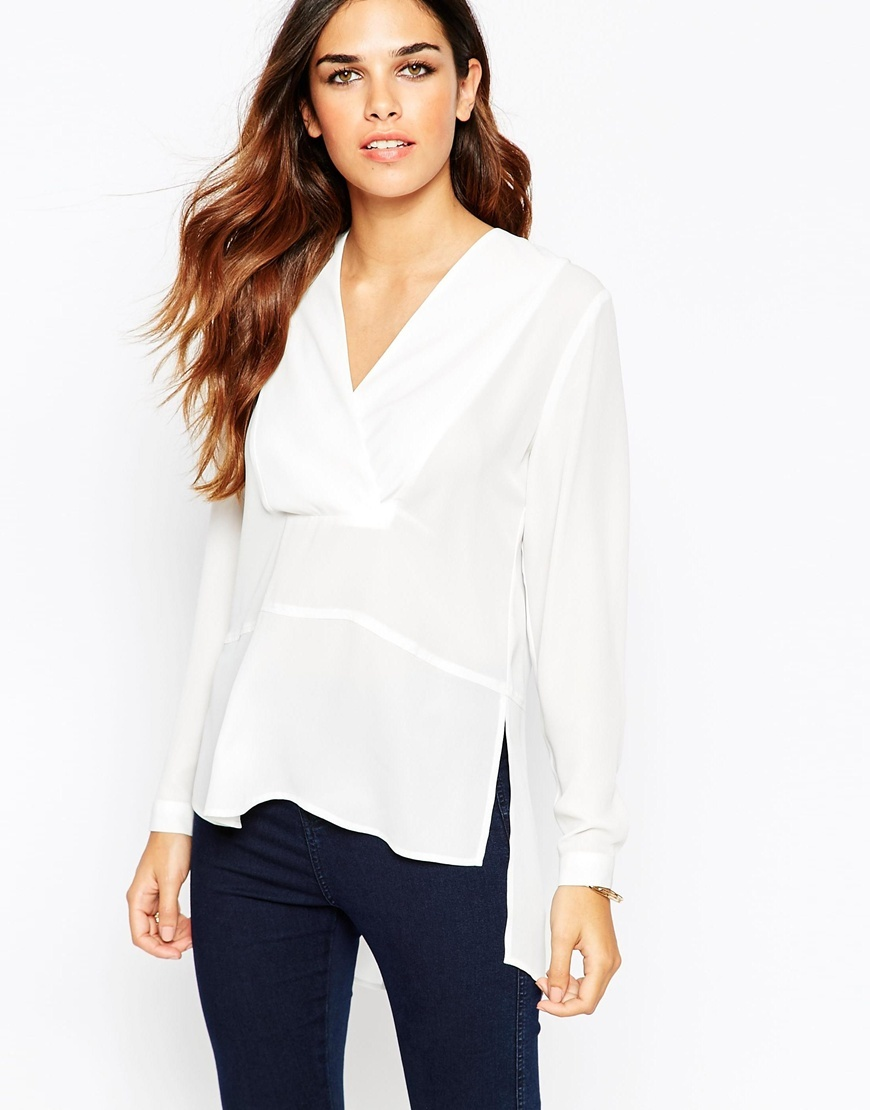 Long Sleeve Deep V Wrap Front Blouse Ivory - neckline: v-neck; pattern: plain; style: blouse; predominant colour: ivory/cream; occasions: casual, creative work; length: standard; fibres: polyester/polyamide - 100%; fit: loose; back detail: longer hem at back than at front; sleeve length: long sleeve; sleeve style: standard; texture group: sheer fabrics/chiffon/organza etc.; pattern type: fabric; season: a/w 2015; wardrobe: basic