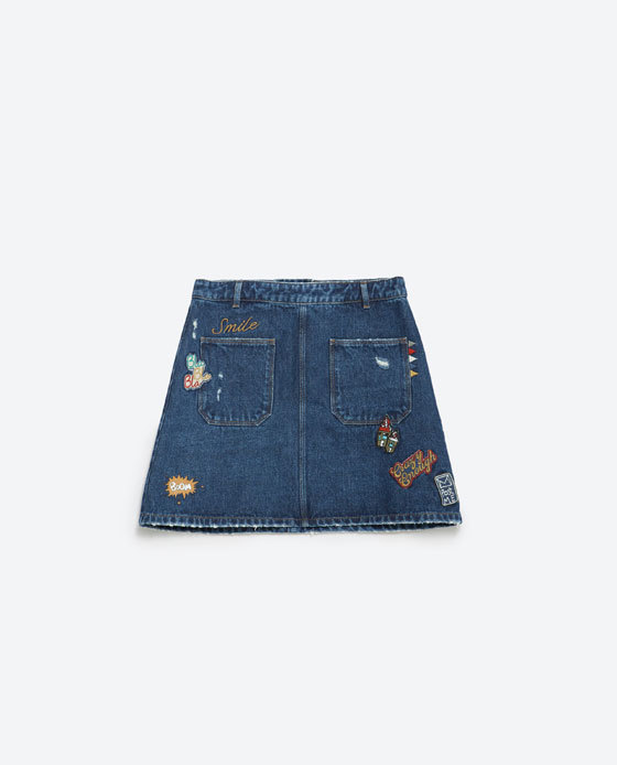 Denim Miniskirt - length: mini; pattern: plain; fit: loose/voluminous; waist: mid/regular rise; predominant colour: denim; occasions: casual, holiday, creative work; style: mini skirt; fibres: cotton - 100%; texture group: denim; pattern type: fabric; season: a/w 2015; wardrobe: basic