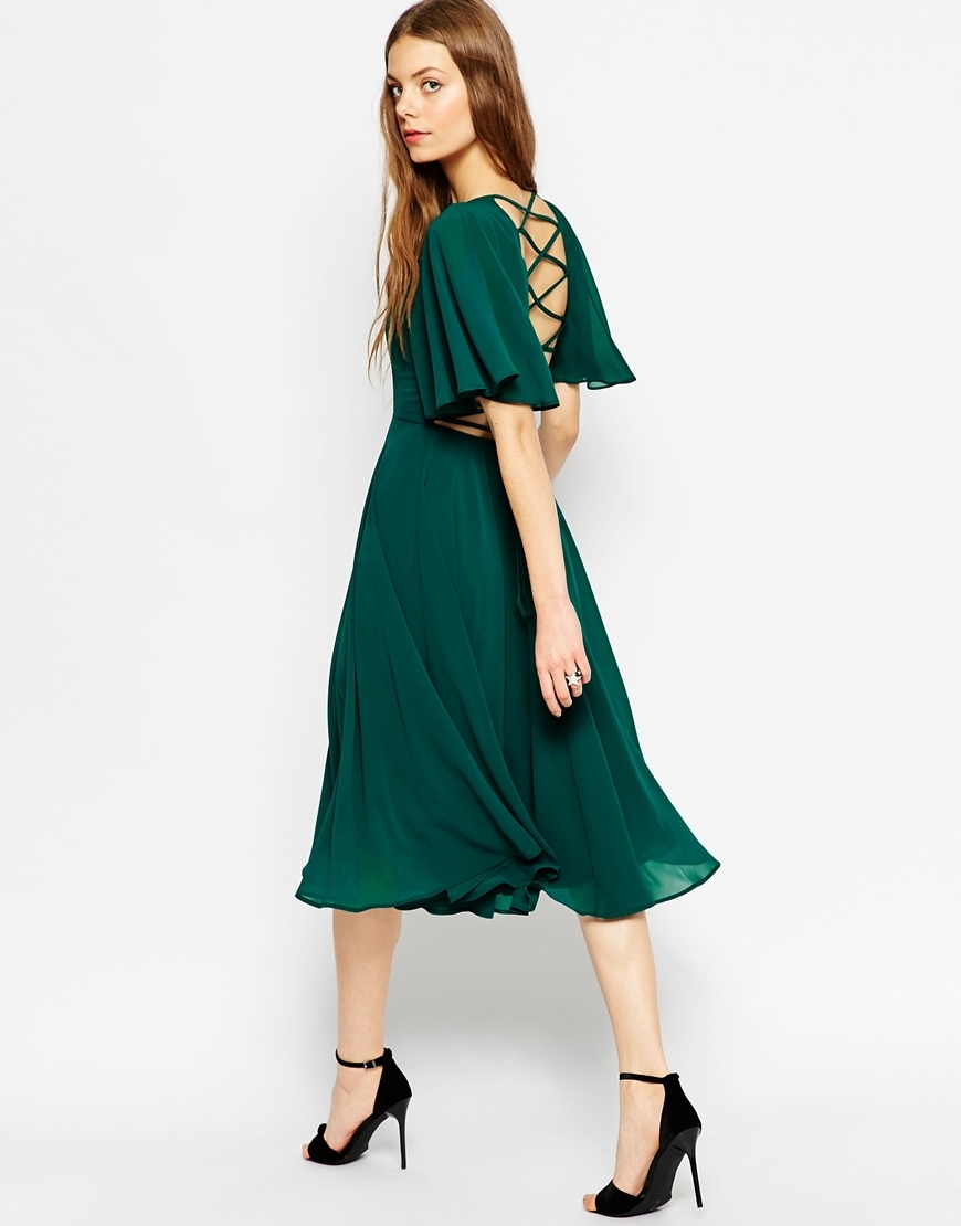 Lace Up Back Kaftan Sleeve Midi Dress Ivory - length: below the knee; neckline: round neck; sleeve style: angel/waterfall; pattern: plain; back detail: low cut/open back; predominant colour: emerald green; occasions: evening, occasion; fit: fitted at waist & bust; style: fit & flare; fibres: polyester/polyamide - 100%; sleeve length: half sleeve; pattern type: fabric; texture group: jersey - stretchy/drapey; season: a/w 2015