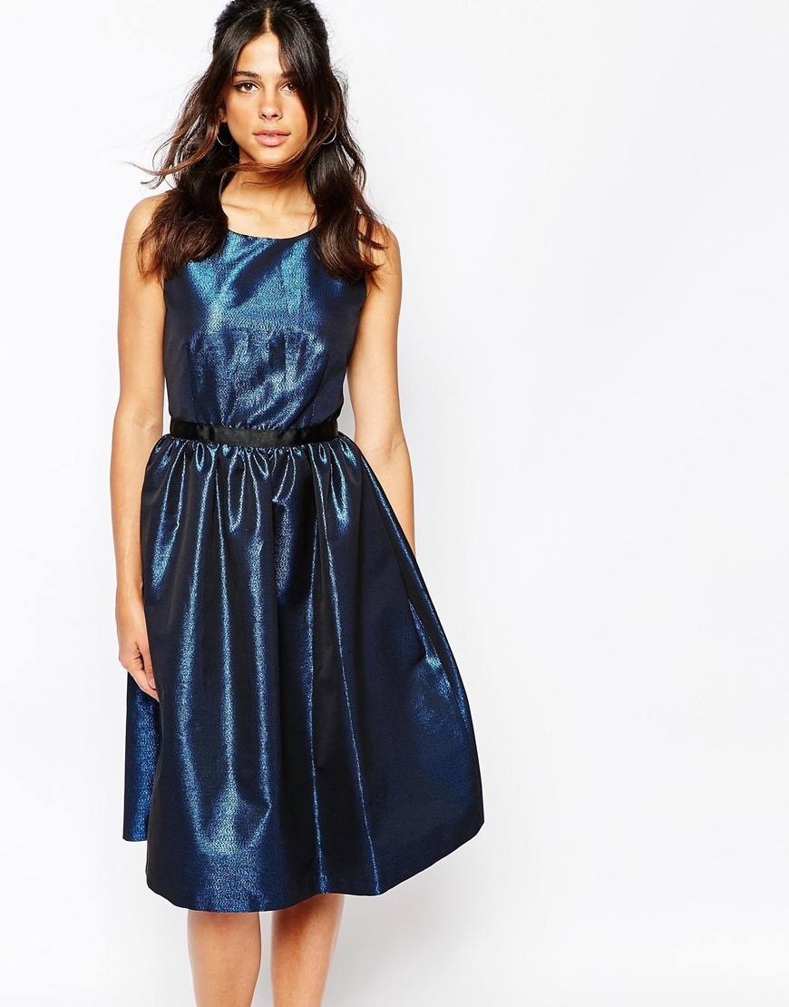 V Back Prom Dress In Blue Metallic Fabric Blue - neckline: round neck; sleeve style: sleeveless; predominant colour: navy; occasions: evening, occasion; length: on the knee; fit: fitted at waist & bust; style: fit & flare; fibres: polyester/polyamide - mix; hip detail: soft pleats at hip/draping at hip/flared at hip; sleeve length: sleeveless; texture group: structured shiny - satin/tafetta/silk etc.; pattern type: fabric; pattern: patterned/print; season: a/w 2015