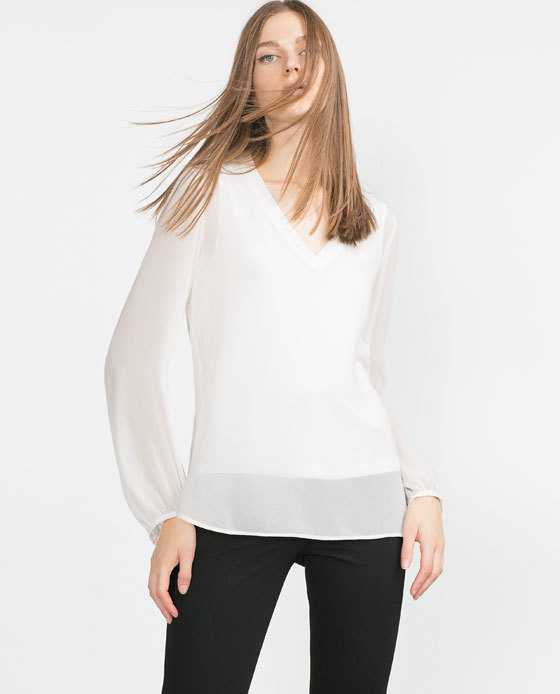 V Neck Top - neckline: v-neck; pattern: plain; style: blouse; predominant colour: ivory/cream; occasions: evening, occasion; length: standard; fibres: polyester/polyamide - 100%; fit: body skimming; sleeve length: long sleeve; sleeve style: standard; texture group: sheer fabrics/chiffon/organza etc.; pattern type: fabric; season: a/w 2015; wardrobe: event
