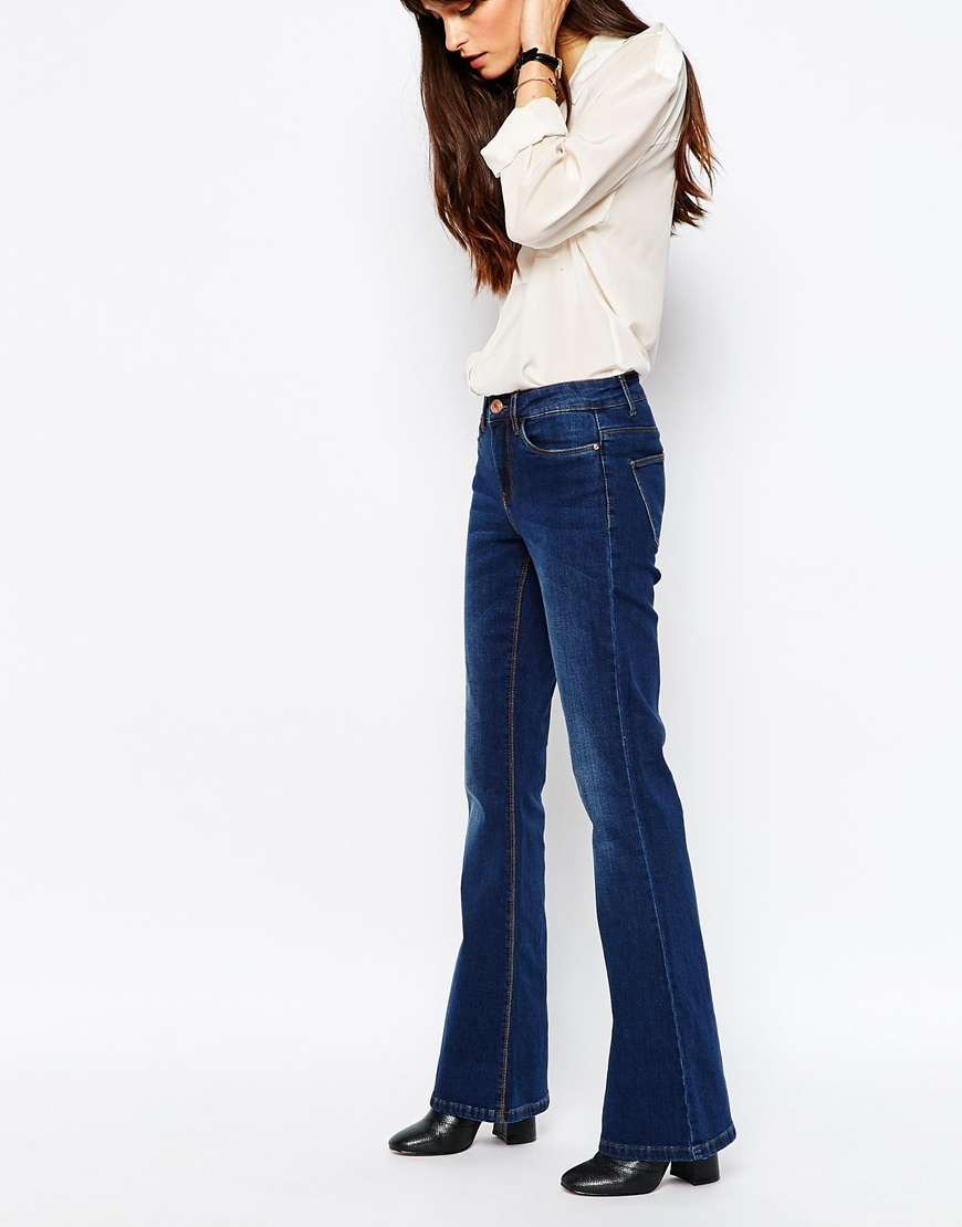 70's Flare Jean Blue - style: flares; length: standard; pattern: plain; pocket detail: traditional 5 pocket; waist: mid/regular rise; predominant colour: royal blue; occasions: casual; fibres: cotton - stretch; jeans detail: shading down centre of thigh; texture group: denim; pattern type: fabric; season: a/w 2015; wardrobe: basic