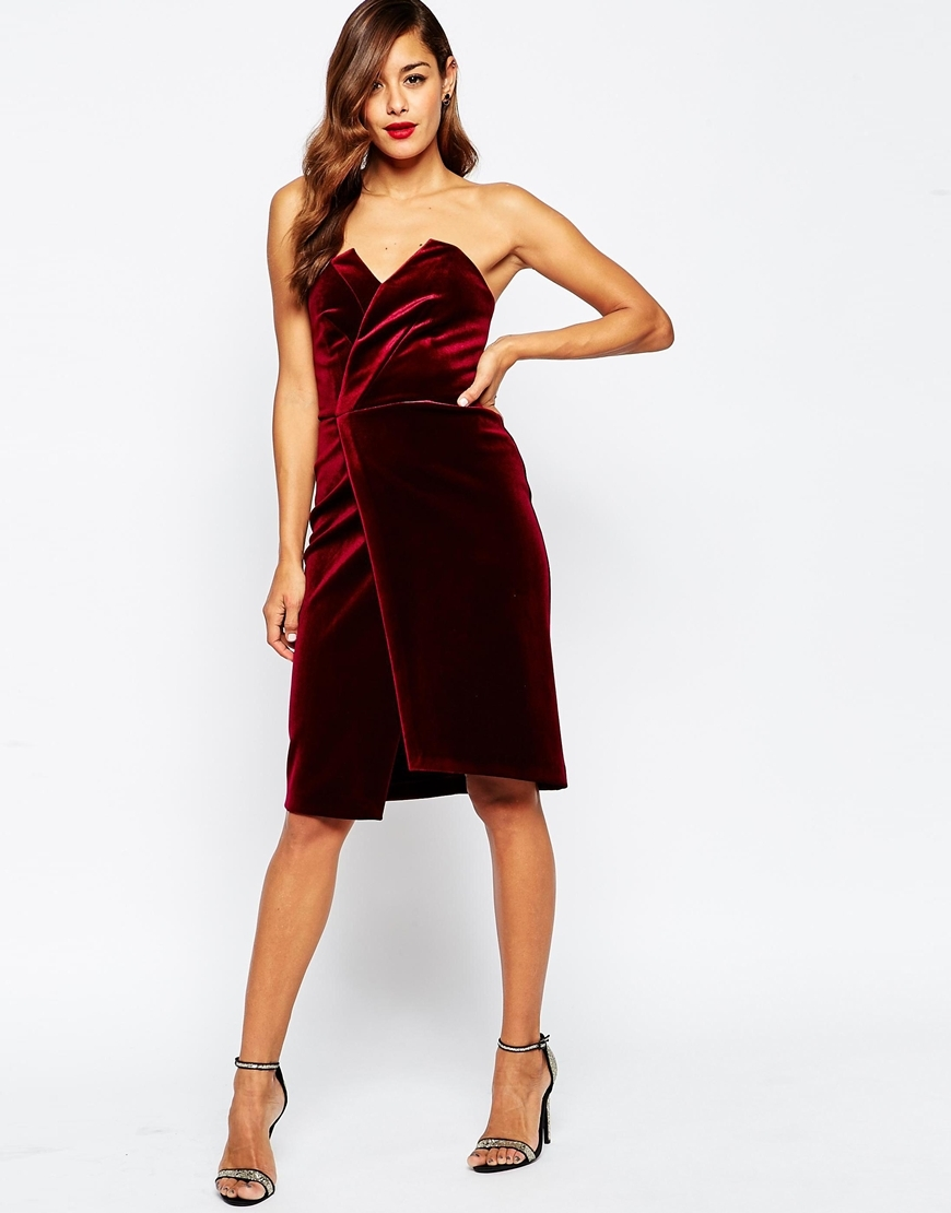 Velvet Asymmetric Bandeau Midi Dress Oxblood - style: shift; neckline: strapless (straight/sweetheart); fit: fitted at waist; pattern: plain; sleeve style: strapless; bust detail: ruching/gathering/draping/layers/pintuck pleats at bust; predominant colour: burgundy; occasions: evening, occasion; length: on the knee; fibres: polyester/polyamide - stretch; hip detail: slits at hip; sleeve length: sleeveless; pattern type: fabric; texture group: velvet/fabrics with pile; season: a/w 2015; trends: romantic goth; wardrobe: event