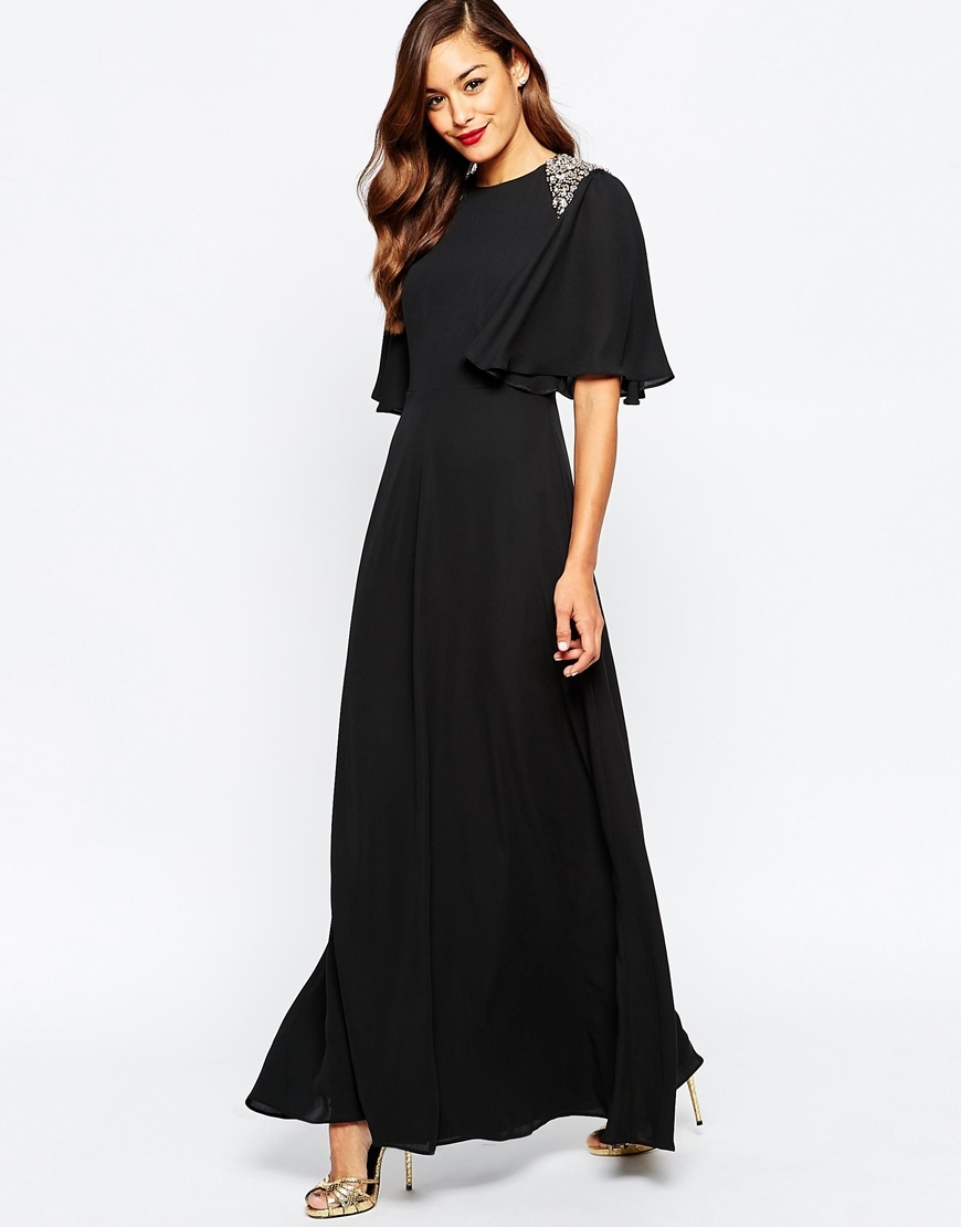 Embellished Shoulder Flutter Sleeve Maxi Dress Black - pattern: plain; style: maxi dress; back detail: back revealing; secondary colour: silver; predominant colour: black; length: floor length; fit: body skimming; fibres: polyester/polyamide - 100%; occasions: occasion; sleeve style: cape sleeve; neckline: crew; sleeve length: half sleeve; texture group: crepes; pattern type: fabric; embellishment: beading; season: a/w 2015; wardrobe: event