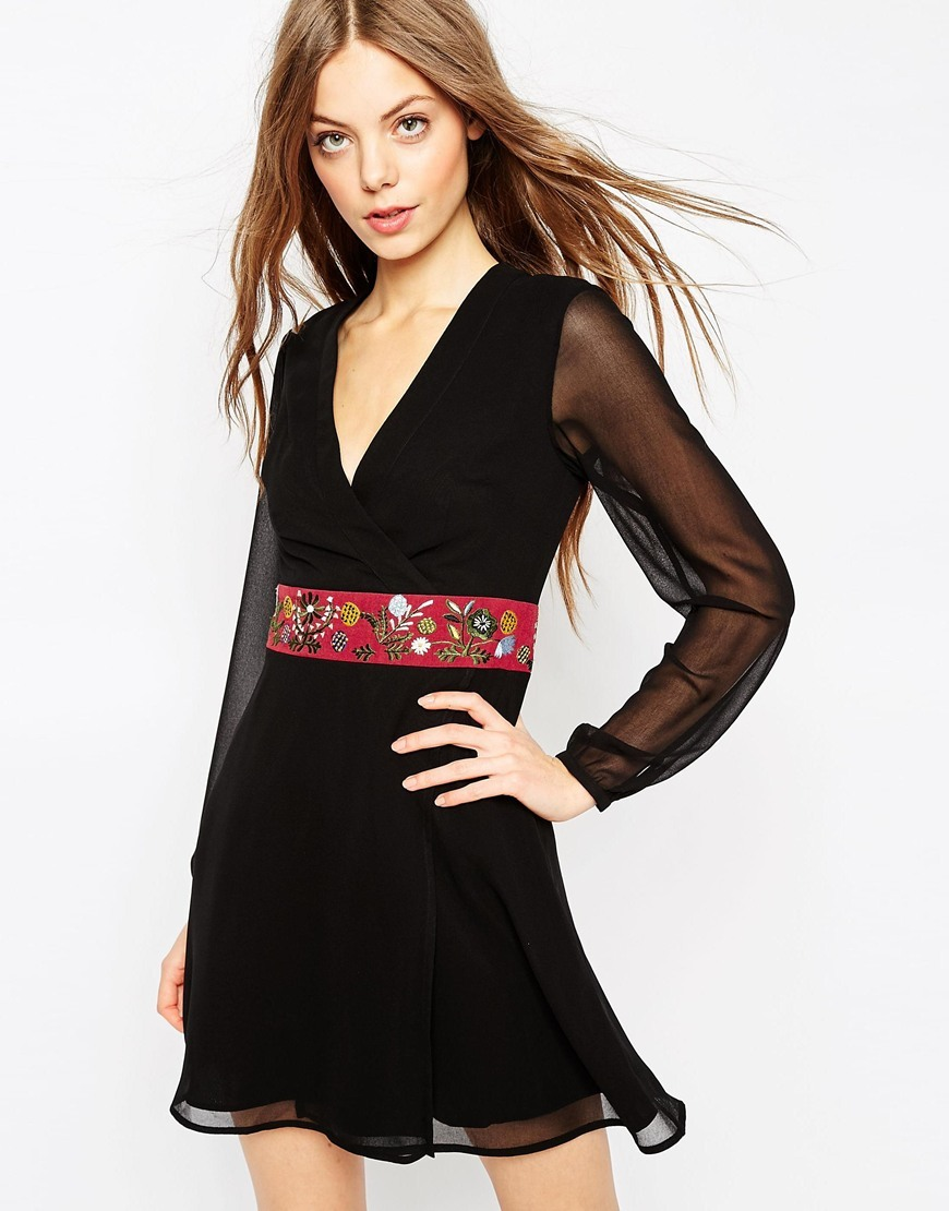 Embroidered Mini Wrap Dress Black - style: faux wrap/wrap; length: mid thigh; neckline: v-neck; pattern: plain; waist detail: belted waist/tie at waist/drawstring; predominant colour: black; occasions: evening; fit: body skimming; fibres: polyester/polyamide - 100%; sleeve length: long sleeve; sleeve style: standard; pattern type: fabric; texture group: other - light to midweight; season: a/w 2015; wardrobe: event